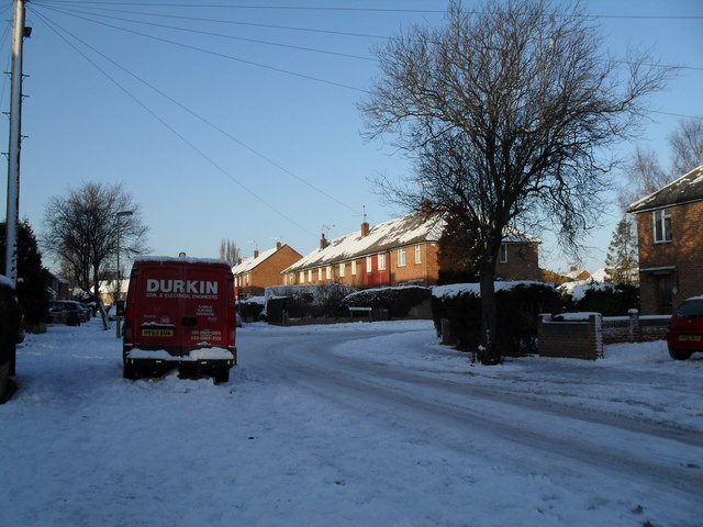 Approaching the junction of  a snowy St John's Road and Awbridge Road