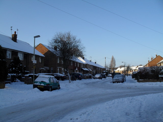 Junction of a snowy St John's Road and Awbridge Road