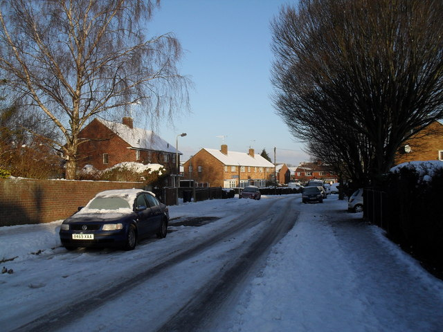 Approaching the junction of  a snowy Awbridge Road and Winchfield Crescent
