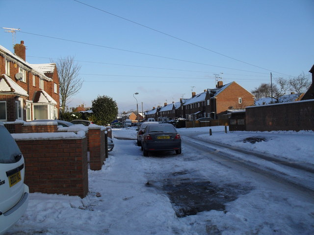 Approaching the junction of  a snowy Linkenholt Way and Bransgore Avenue