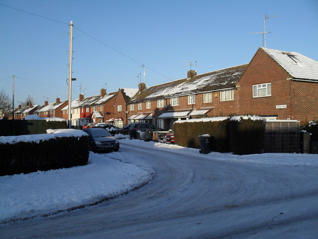Junction of a snowy Hordle Road and Linkenholt Way