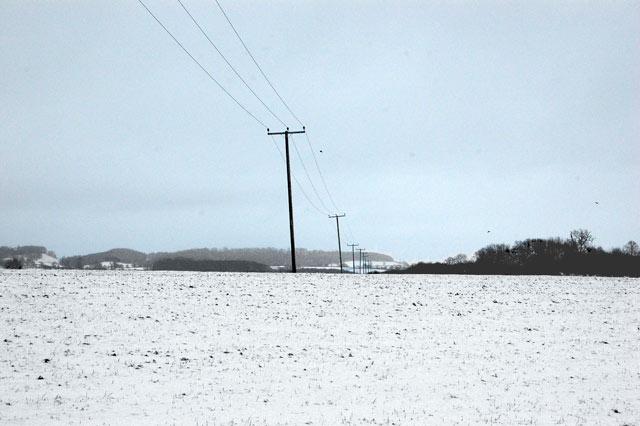 Power poles in a snowy landscape, Broadwell