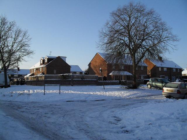 Approaching the junction of  a snowy Bransgore Avenue and Hinton Close