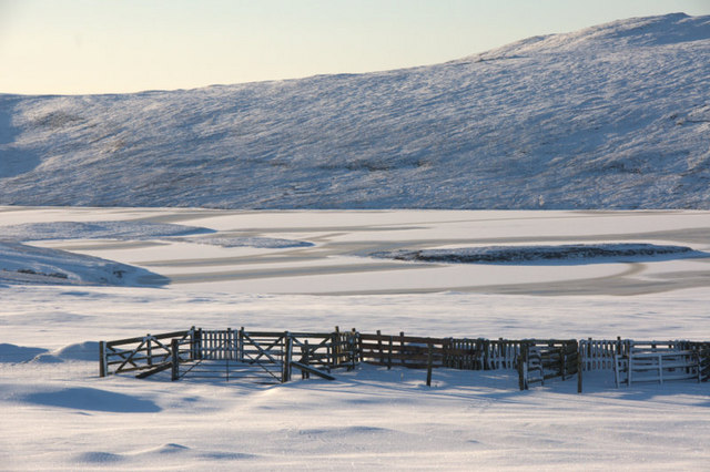 View to frozen Loch of Watlee from Hill of Caldback