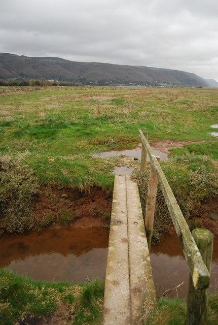 Footbridge over a drainage channel.