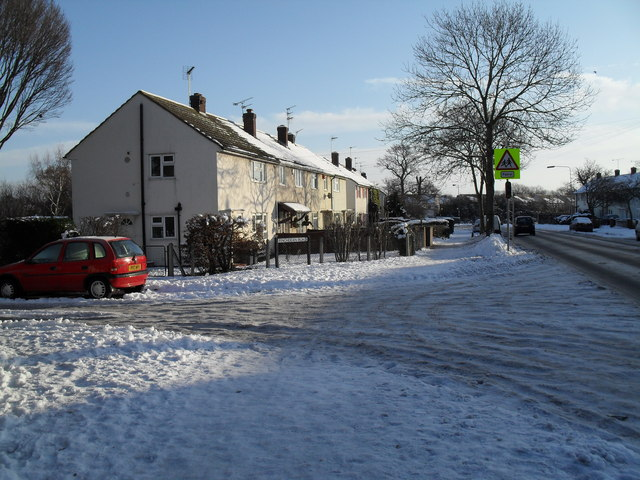 Approaching the junction of a snowy Finchdean Road and Purbrook Way
