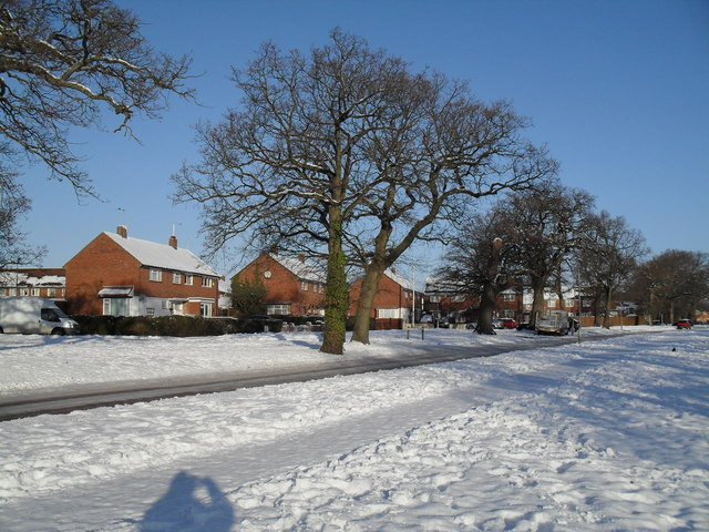 Looking from a snowy Riders Lane towards Highclere Avenue