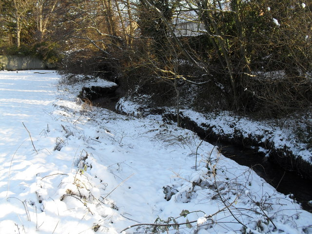 A snowy Hermitage flowing past Leigh Park Vicarage