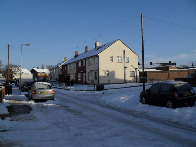 Approaching the junction of  a snowy Ellisfield Road and Blackdown Crescent