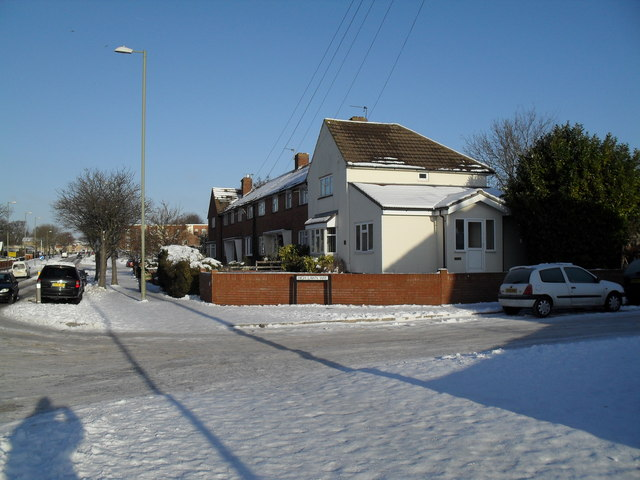 Approaching the junction of  Dunsbury Way and a snowy High Lawn Way
