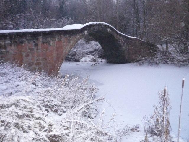 'Roman' Bridge above frozen River Calder
