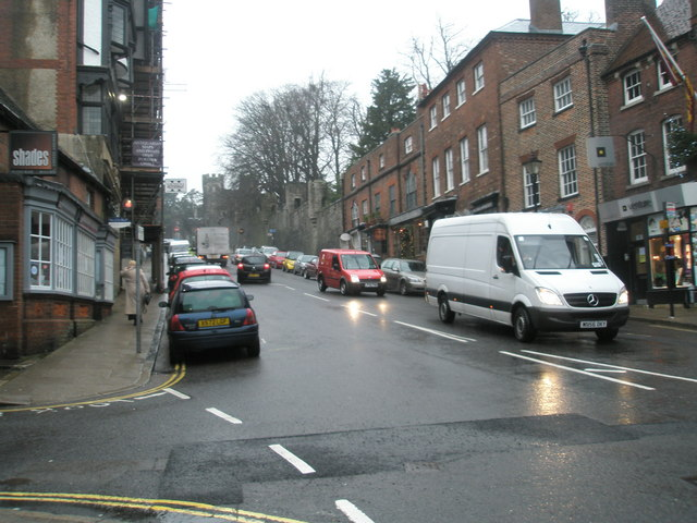 Junction of a soaking Tarrant Street and High Street