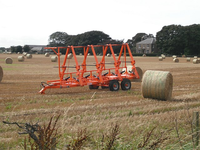 Round bales and wrapper, West Scryne