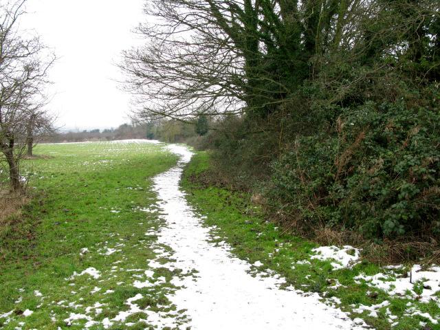 Snow covered footpath heading NE from Marshborough