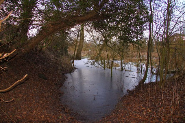The footpath is flooded and frozen