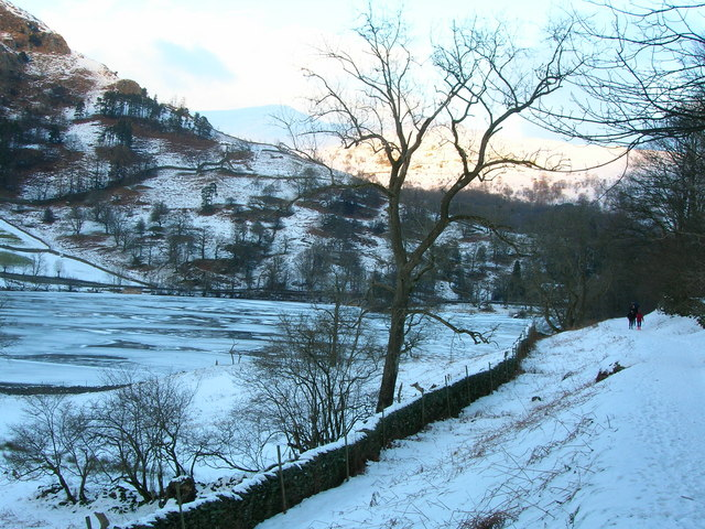 Wall and footpath south of a frozen Rydal Water