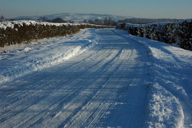 Snow cover road near Kinnersley