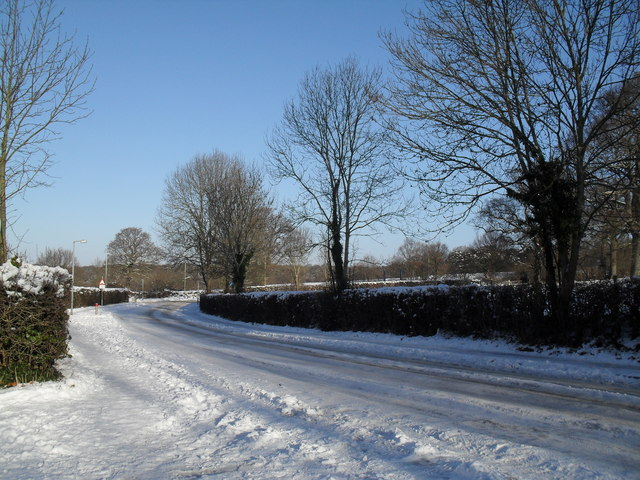 Looking towards the junction of a snowy High Lawn Way and Middle Park Way