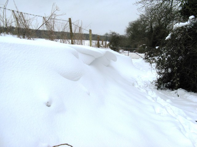 Snow drifts on footpath on Great Down