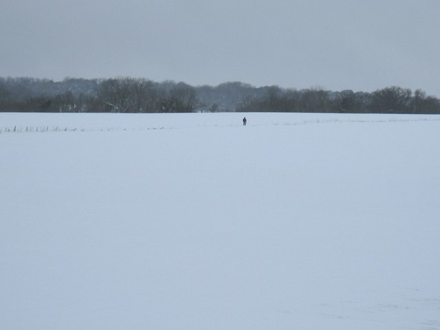 Lone walker striding up Great Down