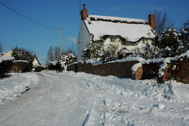 Thatched cottage in the snow