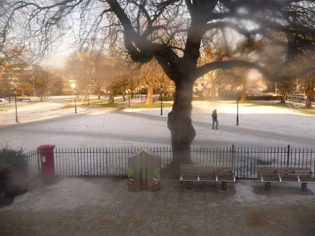 Southampton: snow-covered West Park through a dirty bus window
