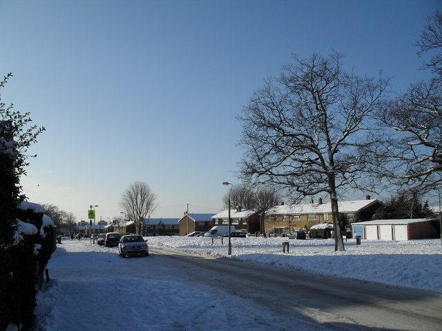 Approaching the junction of a snowy Prospect Lane and Verwood Road