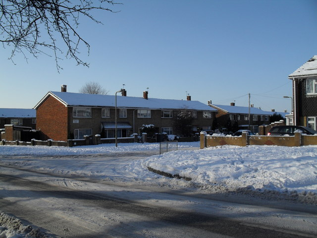 Approaching the junction of a snowy Prospect Lane and Oakshott Drive