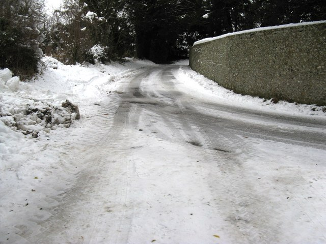 Footpath joins road in Madehurst