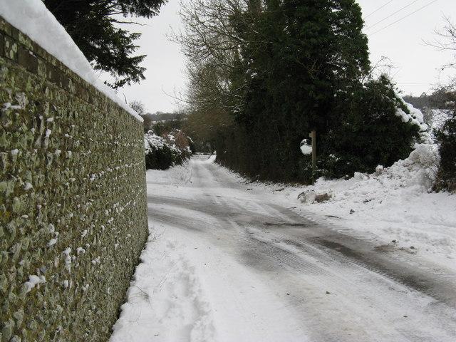 Road mirror on sharp bend in Madehurst