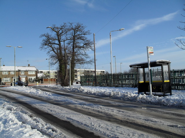 Approaching the junction of a snowy Martin Road and Bartons Road