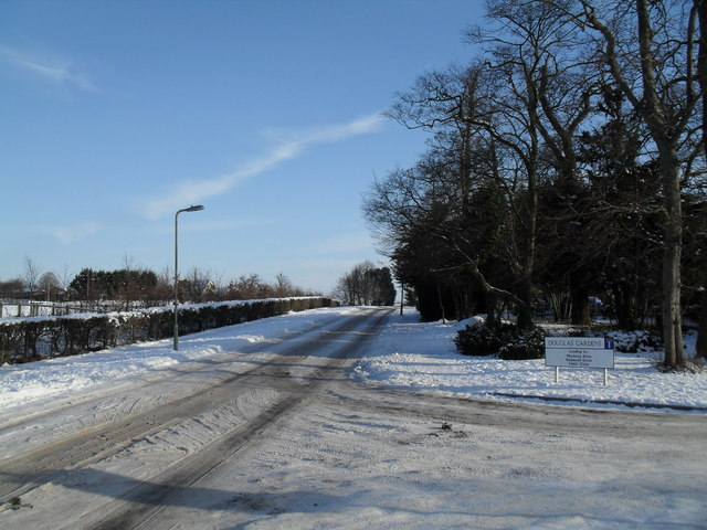 Junction of a snowy Martin Road and Douglas Gardens