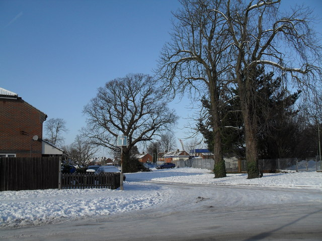 Looking from a snowy St Albans Road into Bartons Road