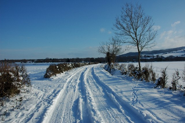 Snow covered road in Birlingham