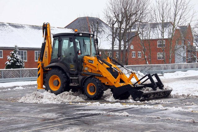 JCB clearing snow from the car park