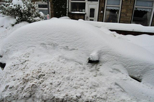 Snowed up car on Bailey st