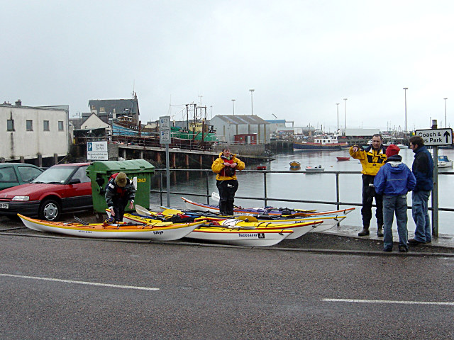 Sea kayakers unloading at Mallaig harbour