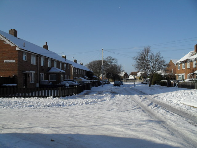 Junction of a snowy Abbotstone Avenue and Swarraton Road
