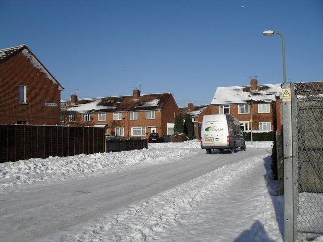 Looking along a snowy Swarraton Road towards Abbotstone Avenue