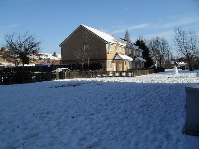 Distant snowman in Lockersley Road