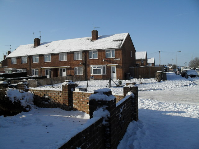 Approaching the junction of a snowy Lockersley Road and Hipley Road