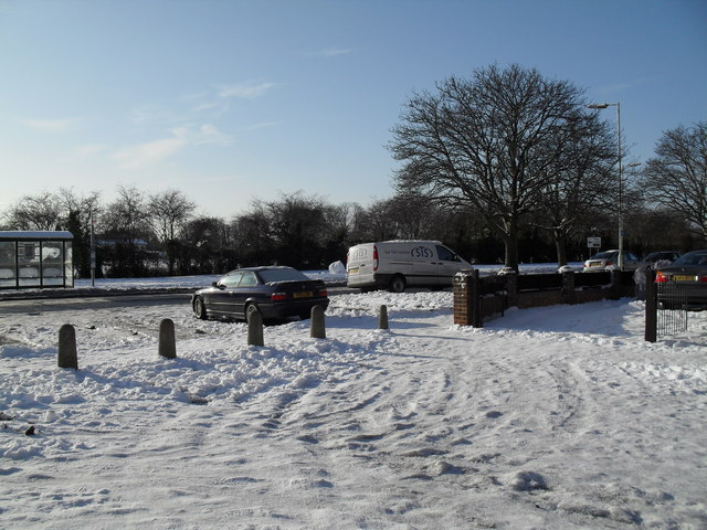 Looking from a snowy Hipley Road into Crossland Drive