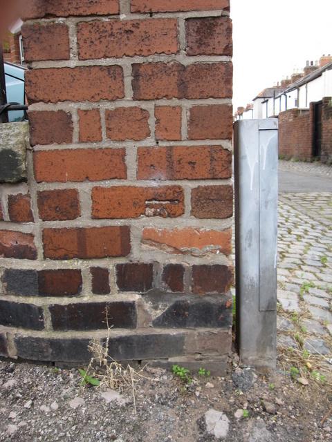 Damaged bench mark in Meadows Lane