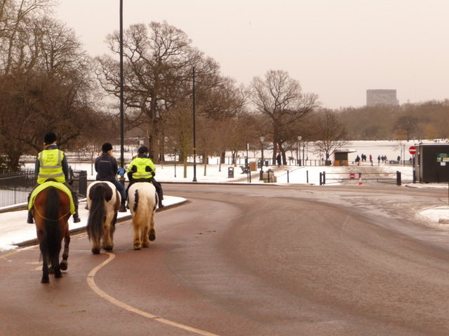 Hyde Park: horse riders pass by