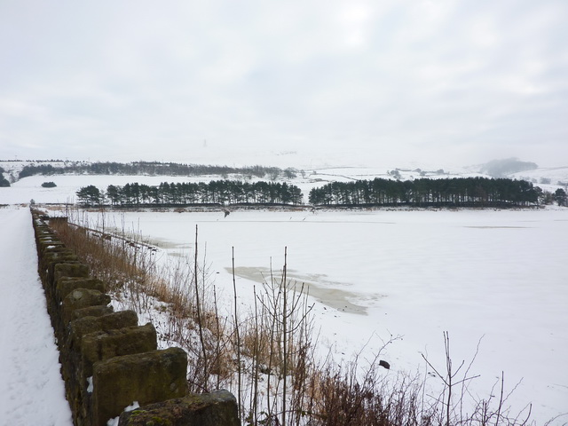 A frozen and snow covered Earnsdale Reservoir