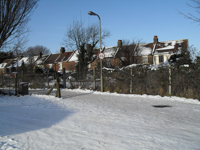 Looking from a snowy Third Avenue across the railway line towards houses in Eastern Road