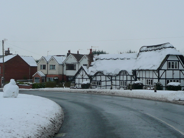 Thatched cottage in snow
