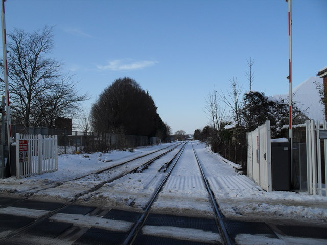 Looking from Warblington Station down a snowy trackside to Havant Station