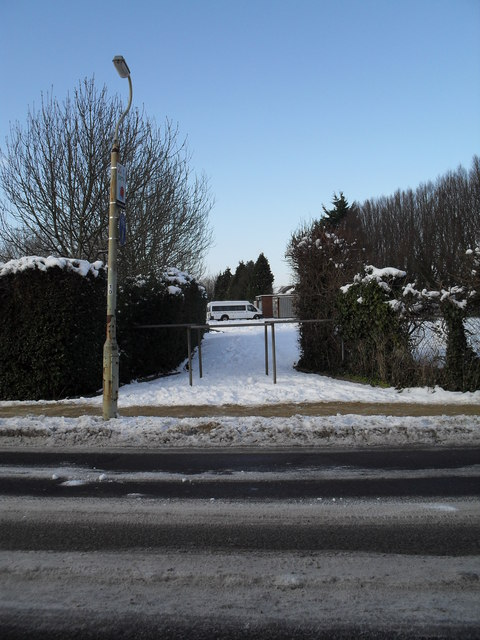 Looking from Southligh Road into a snowy car park at Warblington School