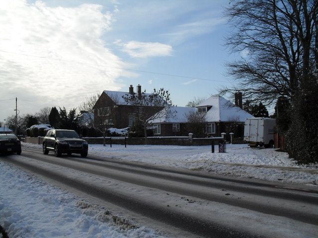 Approaching the junction of a snowy Southleigh Road and Berkeley Square